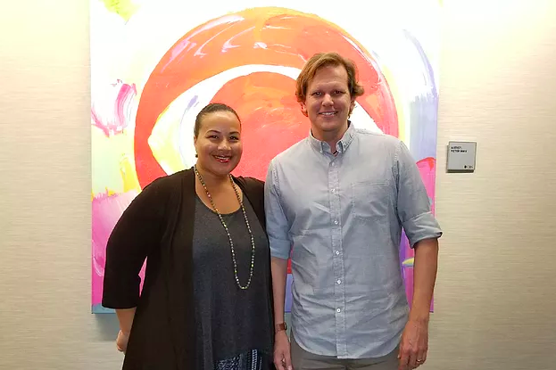 David Tenenbaum and Tiffany Smith-Anoa'i in front of CBS logo artwork