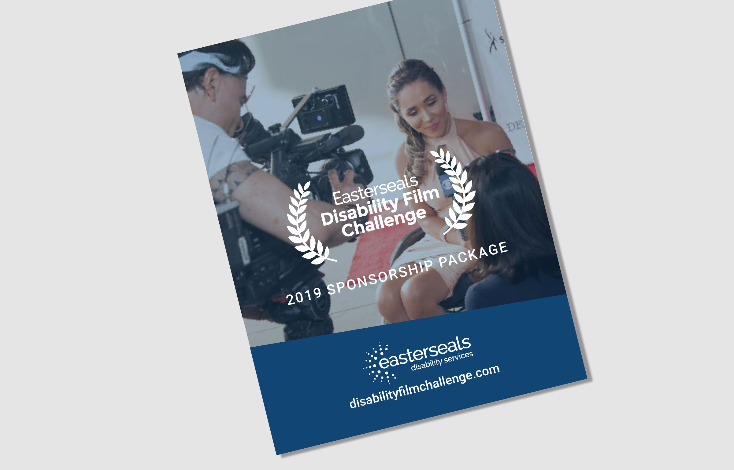 2019 Sponsorship package cover image of a reporter interviewing a Disability Film Participant
